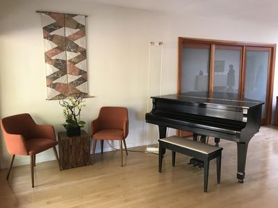 Baby Grand Piano with Sitting Area