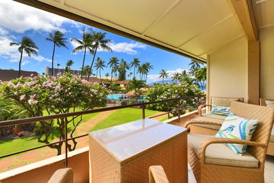 Tropical view of pool and ocean.  Heavenly plumeria blossoms will intoxicate you
