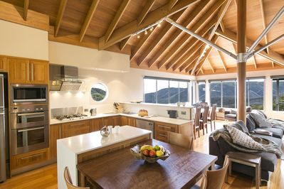 The kitchen with views to the mountain range across the valley