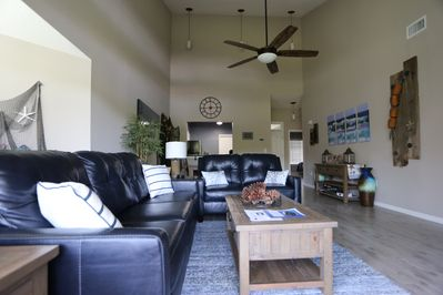 Living and dining rooms with new top grain leather sleeper sofa and love seat