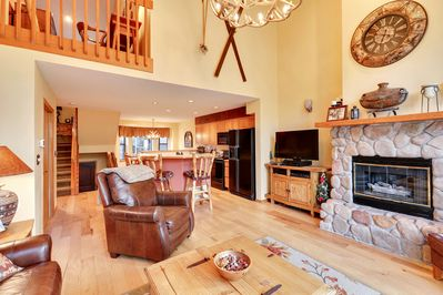 A cozy cabin feel with large stone fireplace