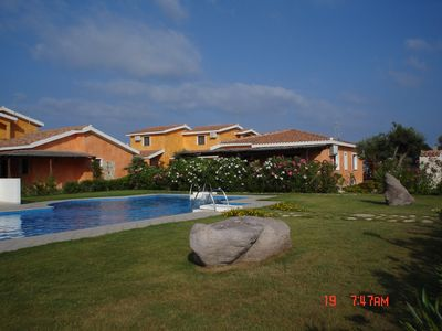 Photo for Detached house with private garden, community pool, private parking space