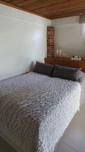 Double bed (140 cm) in downstairs.