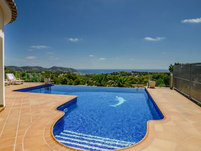 Photo for Great villa in Moraira with unique view, infinity pool and outdoor kitchen