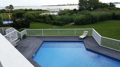 Pool and view from upstairs bedroom balcony