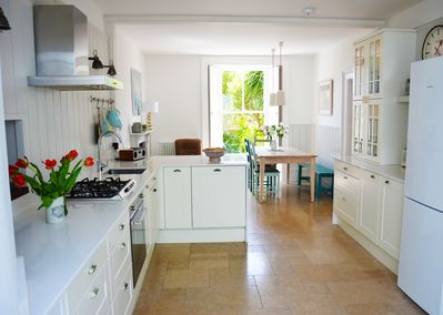 The open plan spacious kitchen which over looks the garden