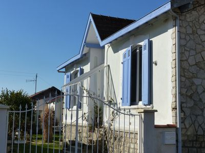 Photo for 2 minutes walk from the beach, close to shops, market, quiet garden