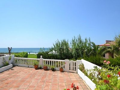 Photo for Air-conditioned apartment with stunning sea views & large ground floor terrace
