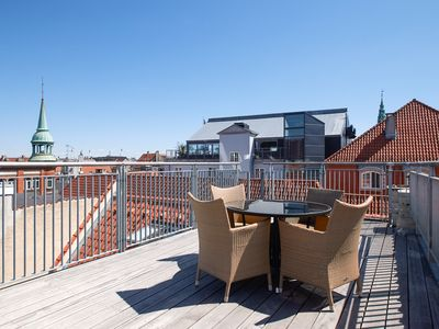 Photo for Bright and modern apartment with a rooftop terrace in the center of Copenhagen