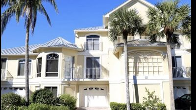 Photo for Family Friendly large condo walking distance to beach and restaurants.