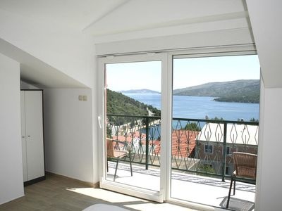 Photo for Two bedroom apartment with balcony and sea view Marina (Trogir) (A-11607-a)