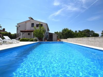 Photo for Lovely apartment with private balcony, pool with deckchairs, fenced garden, bbq