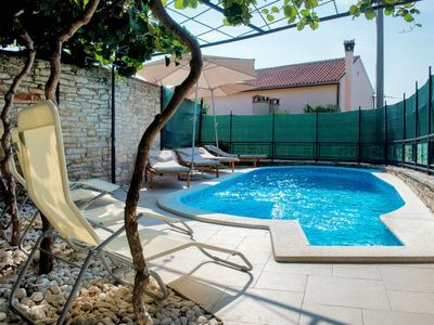Photo for 4 bedroom Villa, sleeps 8 in Divšići with Pool, Air Con and WiFi