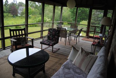 screened porch overlooking conservation land