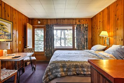 Enter the condo and marvel at the knotty pine walls.
