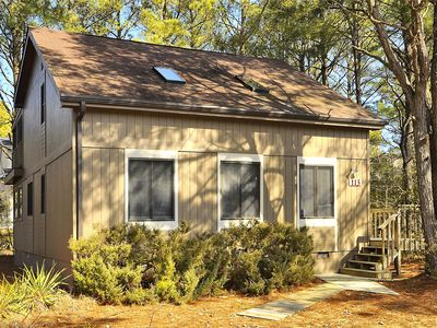 Photo for FREE ACTIVITIES INCLUDED!! Bright and cheery house only a short walk to the beach!  Some features include 3 bedrooms plus den, 2 baths