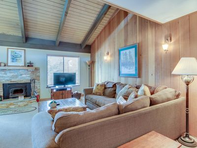 Photo for Cozy getaway with loft and on-site shared hot tub, sauna, and pool!