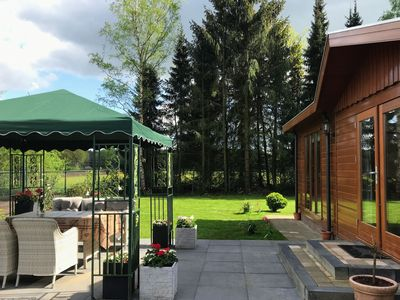 Photo for Chalet in holiday park with spacious living room, large enclosed garden and unobstructed view