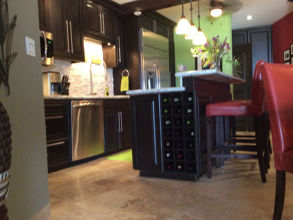Magnificent Pull Out Kitchen Table a pull out island this clever island on wheels pullw out from the cabinetry as Modern High End Kitchen With Island Wine Rack Large Pot Drawerspull