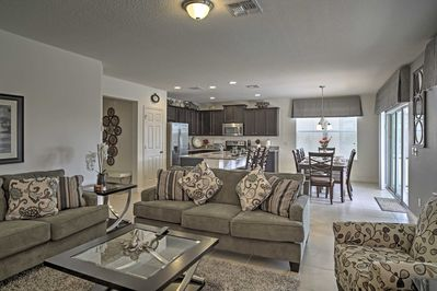 The living room offers plenty of plush seating for your group.