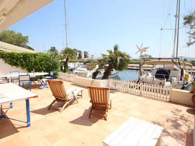 Photo for Large house with WIFI, a very large terrace, a 14m-mooring and sea view