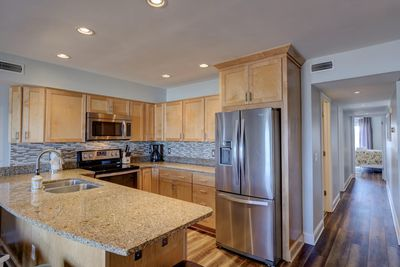 Modern kitchen with all stainless steel appliances and granite countertops