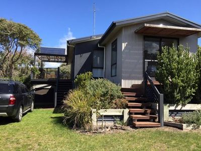 Big, clean family sized home close to beach and overlooking playground.