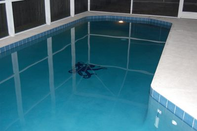 Heated pool with fully screened in area and lights for evening swims.