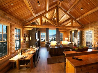 Bright panoramic views, exceptional air space, log trussed 20' vaulted ceiling