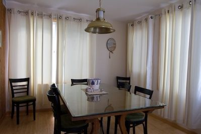 This Glass Covered Dining Room Table seats 8 for Dinner or a Card game or just some old fashioned Conversation.