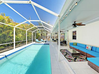 Pool - Gorgeous screened pool and comfy seating under a ceiling fan. Your immaculate rental is professionally managed and maintained by TurnKey Vacation Rentals.