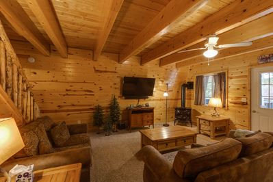 Relax in this comfortable Living room that has a large flat screen TV and corner fireplace to keep you toasty warm in winter or just use for ambiance at night.