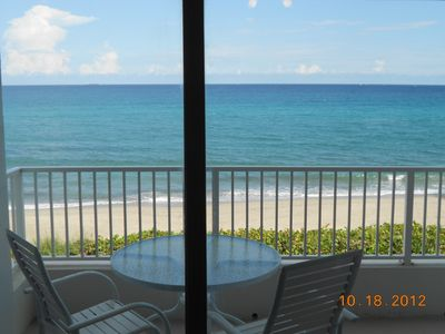 View from the bedroom of balcony overlooking the ocean.