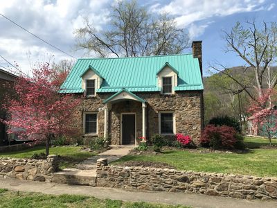 Photo for River front home, walkable to Hot Springs Spa & downtown - Red Bridge Cottage