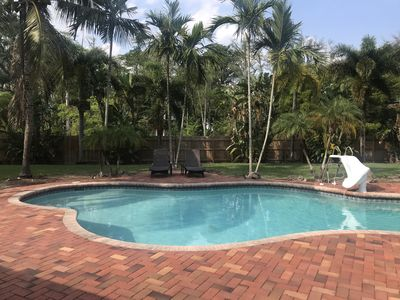 Photo for Palm Trees, Paradise and Saltwater Pool await you at this 3 bed / 2 bath oasis