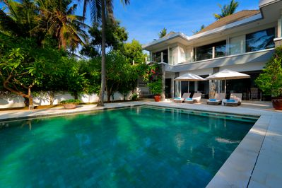 Elegant villa with outdoor pool and lush greenery