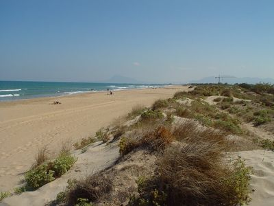 Photo for Only 20 meters to the dune beach, sea views, pool, betw. Oliva u. Gandia seafront