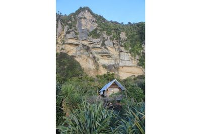 Surrounded by bush and limestone cliffs