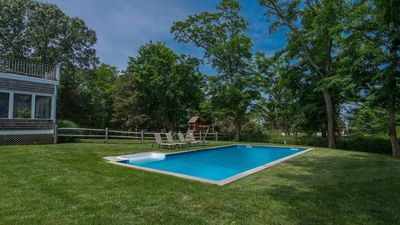 Photo for New Listing: Bay-View Home with Heated Pool, Tennis Court, Steps to Secluded Peconic Bay Beach