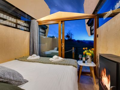 Photo for Relax in front of the fire or open up the roof to admire the wonders of the milky way from the comfo