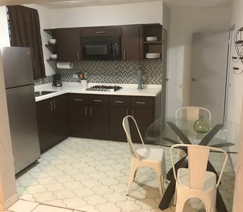 Kitchen area with a dinning set. Kitchen has all the equipment to cook