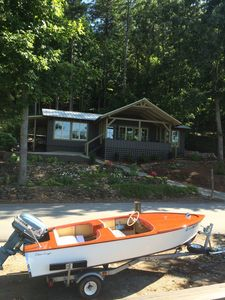 The cottage with our friend's wooden boat parked in front!