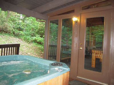 Hot tub into sunroom - side steps ease entry into Hot Tub