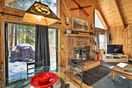 Vaulted and beamed wood ceilings create an open and rustic feel.