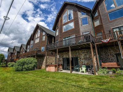 Enjoy lake access and ski slope views!