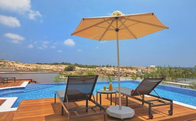 Photo for Ammos Kambouri Villa - Luxury 3 Bedroom Villa with Air Conditioning, Private Pool, Sea Views, only 20 Meters to the Beach ! FREE WiFi