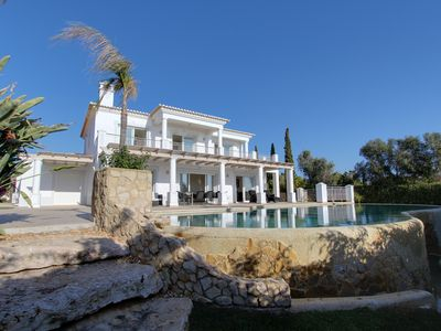 Photo for Stunning modern 4 bedroom villa. Fabulous views over sea and village