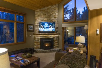 Our spectacular fireplace and surrounding picture windows