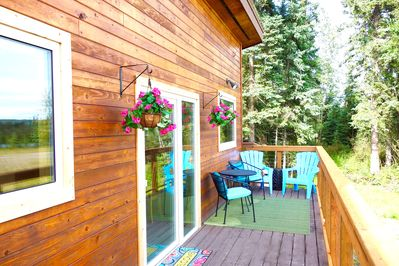 The front deck of the cabin is a great place to relax and enjoy the midnight sun