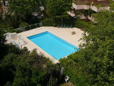 Photo for 2 Bedroom with Panoramic Views, Swimming Pool and Parking, minutes to the Beach